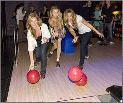 The Hills girls do a little bowling in promotion of the new season.