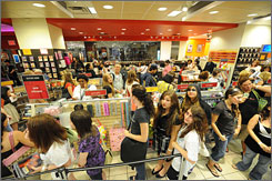 Twilight fans at midnight: Customers buy the first books at the Breaking Dawn midnight release party at a Columbus Circle Borders in New York. Stephenie Meyer's latest broke publisher Hachette Book Group's one-day sales record with an estimated 1.3 million copies.