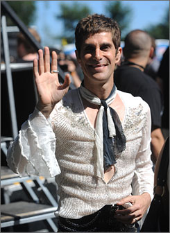 On and off the stage: Festival organizer Perry Farrell also performed with guitarist Slash.