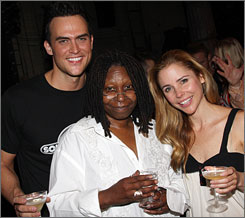 On wheels: Cheyenne Jackson, left, Whoopi Goldberg and Kerry Butler star in the roller-skating romance/musical Xanadu.