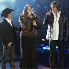 Texan Melissa Lawson, 32, lets the good news sink in after winning the fourth edition of Nashville Star Monday night. She's flanked by runner-up Gabe Garcia, left, and host Billy Ray Cyrus.