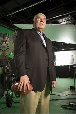 On the ball: John Madden takes a break from shooting a spot for Madden NFL 09. It arrives at midnight Tuesday.