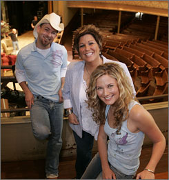 Sugarland has been operating as a duo since orignal member Kristen Hall, center, quit the band in 2005. Hall's recently filed lawsuit claims she had an agreement to continue sharing profits and losses with remaining members Kristian Bush, left, and Jennifer Nettles.