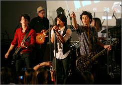 "The Jonas Brothers perform a ""secret"" show for screaming fans at the Apple Store in the Soho area of New York City."