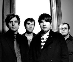 Four members  now: Micah Carli,  left, Eron Bucciarelli,  JT Woodruff  and Matt Ridenour  are Hawthorne  Heights. They lost  Casey Calvert  in November  2007.