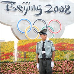Tight control: A security officer stands guard in Tiananmen Square.