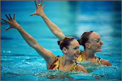   The human fountains: Canadian synchronized swimmers Isabelle Rampling, left, and Marie-Pierre Gagnon Boudron.   