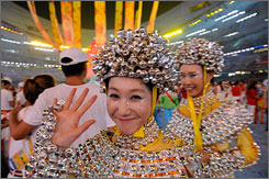Ringing out the Summer Games: More than  1,000 silver bell dancers performed at the closing ceremonies in Beijing.