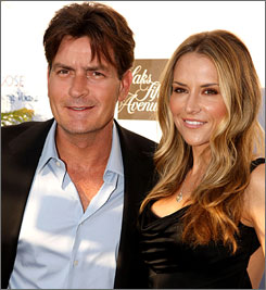Charie Sheen and Brooke Mueller, who married in May, are expecting a child. He has three daughters from previous relationships.