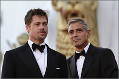Brad Pitt and George Clooney pose on the red carpet at the Film Festival in Venice on Wednesday.