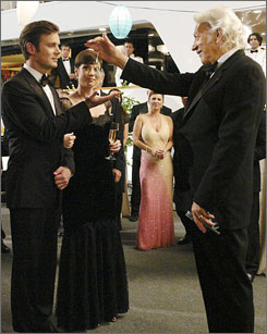 Guilty pleasure: Peter Krause, left, Zoe McLellan and Donald Sutherland.