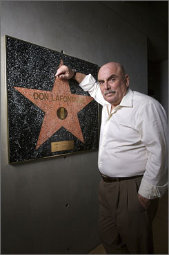 "Don LaFontaine, who gave voice to all those movie trailers that began with the phrase ""In a world..."" , has died at 68."