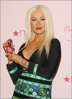 Take a whiff: Christina Aguilera at Tuesday's launch of her fragrance, Inspire, at Macy's Herald Square