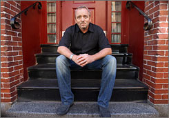 """Boston guy: Dennis Lehane, here hanging out in the city's North End, examines the 1919 police strike in the 704-page novel The Given Day, out Sept. 23. """"I've always liked historical epics, so why not write one?"""""""