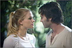 Smitten: Anna Paquin's Sookie falls for Stephen Moyer's vampire Bill.