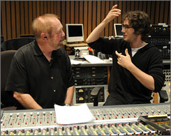 Medley men: Josh Groban, right, talks to executive producer Ken Ehrlich during a rehearsal for the theme-song tribute.