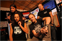 Looking to reclaim metal throne: Rob Trujillo, left, Kirk Hammett, Lars Ulrich and James Hetfield of Metallica.