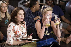 Baby Mama: Tina Fey, left, can't have kids, so she  hires Amy Poehler as a surrogate mother.