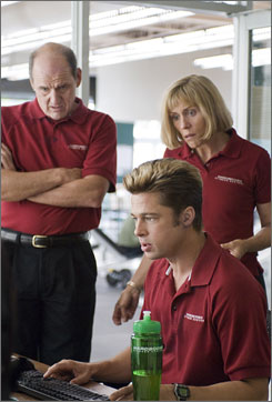 Seeing dollar signs: A CIA operative's memoirs fall into the hands of two gym employees, Brad Pitt, front, and Frances McDormand. At left is Richard Jenkins.