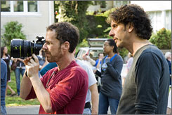 On the set: Writers/directors Ethan, left, and Joel Coen at work on Burn After Reading.