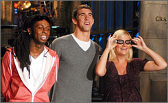Saturday Night Live regular Amy Poehler gets goggle-eyed with this week's host, Michael Phelps, and musical guest Lil Wayne.