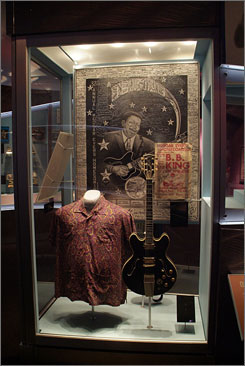 Shirt off his back: King's trademark paisley shirt, guitar and a poster.