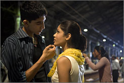 "Teen love: Dev Patel is ""steely"" orphan Jamal, and Freida Pinto is Latika."