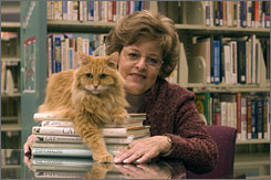 Check him out: Librarian and now author Vicki Myron and Dewey Readmore Books at the Spencer Public Library in 2003. Dewey died in 2006.