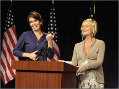 Winning ticket: Tina Fey, left, and Amy Poehler rehearse their Saturday Night Live season-opening sketch.
