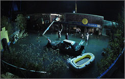 Streets of Blood: Crews set up a shot of a flooded New Orleans at the Louisiana Wave Studio in Shreveport. Film companies get tax credits for shooting inside the state.