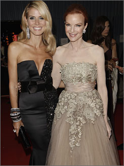 Heidi Klum and Marcia Cross catch up at the Governor's Ball.