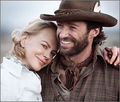 Nicole Kidman, seen here with her Australia co-star Hugh Jackman, credits the water of a small town in the Outback with helping her get pregnant.