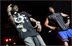 Public Enemy's Fight the Power top VH1's list of 100 greatest hip-hop songs. Group members Flavor Flav and Chuck D, above, perform at the Pitchfork Music Festival in July.