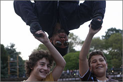 David Blaine greets fans as he hangs upside down in Central Park.