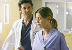 Back on track: Derek (Patrick Dempsey) and Meredith (Ellen Pompeo) seem to be together for good  finally.