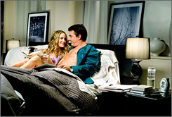 Sex and the City: New York columnist Carrie (Sarah Jessica Parker) cuddles with Mr. Big (Chris Noth).