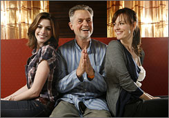 A director sandwich: Jonathan Demme with Anne Hathaway, left, and Rosemarie DeWitt, who star in his latest film, Rachel Getting Married.