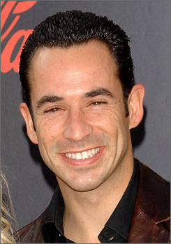 Race car driver Helio Castroneves is accused of hiding money from the IRS in offshore accounts. He will answer charges Friday at a federal courthouse in Miami.