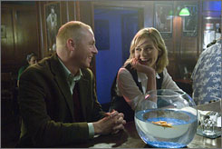 Sharps shooters: Simon Pegg and Kirsten Dunst  are magazine co-workers, and maybe more.