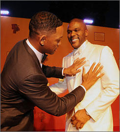 Will Smith helps Tyler Perry get camera-ready at the unveiling of Perry's new TV and film studio in Atlanta Saturday.