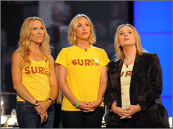 Breast cancer survivors: Sheryl Crow, left, Christina Applegate and Melissa Etheridge stand up to cancer.