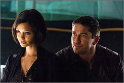 Rockin' the Cockney: Thandie Newton, left, and Gerard Butler.