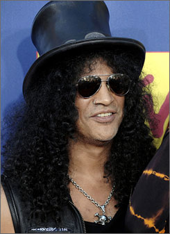"""""""The legion of guitar players I grew up listening to would have been completely different had Les not been around,"""" Slash said."""