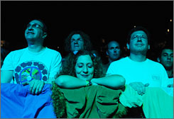 Ken Amron, left, of New Jersey, Tiffany Lake of Long Island, and Jeremy Grossbard of Arizona enjoy a show by the surviving members of the Grateful Dead, who played an Obama fundraiser Monday at Penn State University.