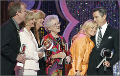 Maureen McCormick, second right, joins castmates Mike Lookinland, left, Florence Henderson, Susan Olsen, Ann B. Davis and Christopher Knight at the 2007 TV Land Awards. They say she did not tell them what's in her new tell-all book.
