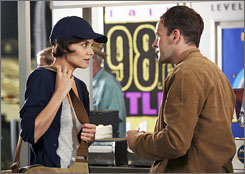 Snack attack: Eli Stone (Jonny Lee Miller) learns that Grace Fuller (Katie Holmes) is not a figment of his overheated imagination on next Tuesday's show.