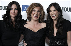 "Demi Moore, right, Kirsten ""Kiwi"" Smith, center, and Courteney Cox pose together at Glamour Reel Moments in Los Angeles on Tuesday."