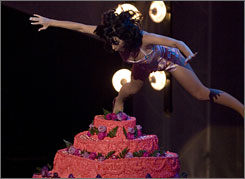 Katy Perry dive-bombed a birthday cake during her performance at the Latin American vervsion of the MTV Video Music Awards Thursday.