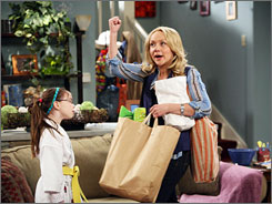 Package deal: Nicole Sullivan stars as Rita, busy mom and band member. Kelly Gould plays precocious daughter Shannon.