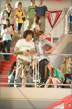 In it together: Corbin Bleu, left, and Zac Efron will hit theaters Friday.
